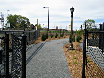 Photo of the gate and path leading to the Lowertown Dog Park