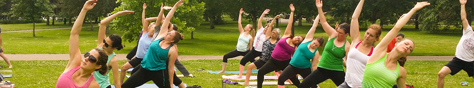 Saint Paul residents practicing yoga in a park