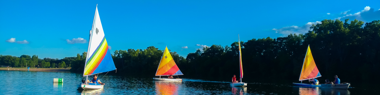 Sail boats on a river