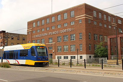 Green Line Train in front of Carleton Lofts