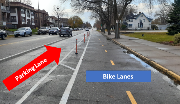 Photo of Grand Ave between Dunlap and Ayd Mill bridge showing the parking lanes on the north side between the temporary bike lanes and the westbound driving lane.