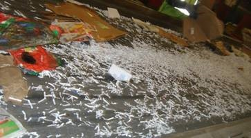shredded paper spilled on sorting line at a Materials Recovery Facility