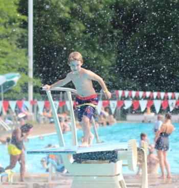 Boy on Highland Park Aquatic Center diving board