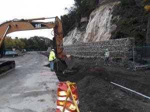 prepping the area for the sidewalk construction near the gabion wall on Wabasha Street in Saint Paul