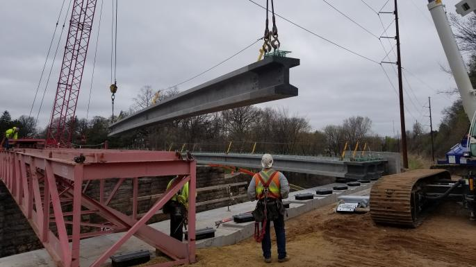 beam set over railroad
