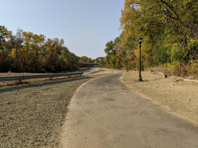 Photo of Ayd Mill Road construction as of 10.10.20. Photo shows the new light poles along the trail as seen north bound from Jefferson Avenue.