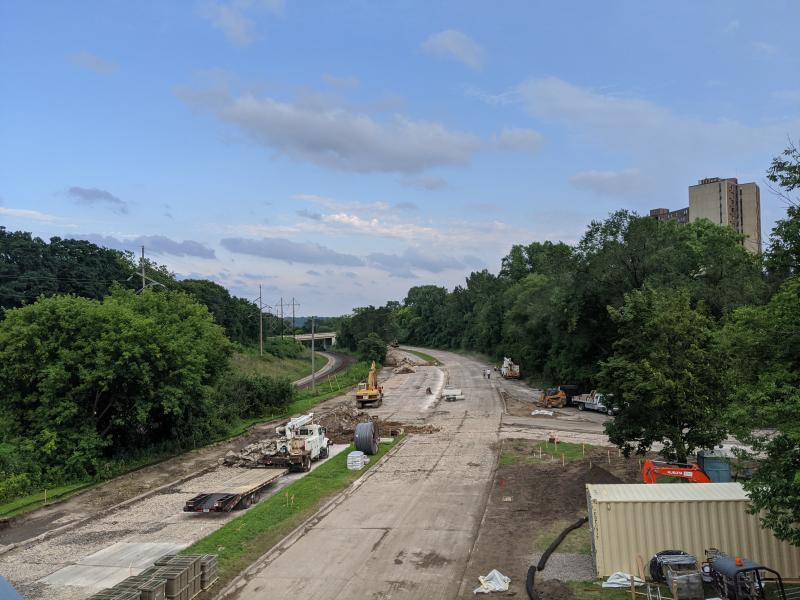 Ayd Mill Road under construction on 8.14.20. View from St. Clair overpass. Concrete road cut and rubbilized process underway. Trucks and other equipment in construction area.