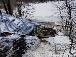 installing sewer end cap at Como Lake