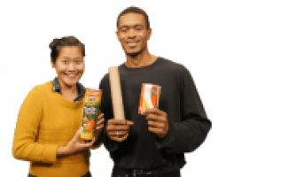 Image of 2 individuals holding recyclable items