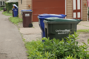Picture of a Saint Paul alley with different garbage carts and recycling carts