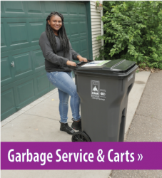 Photo of a woman standing with a garbage cart, button link to Garbage Service and Carts.