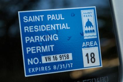 Parking permit sticker on car