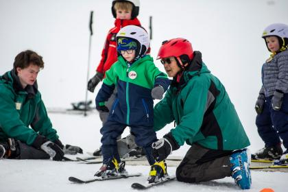Youth taking ski lessons